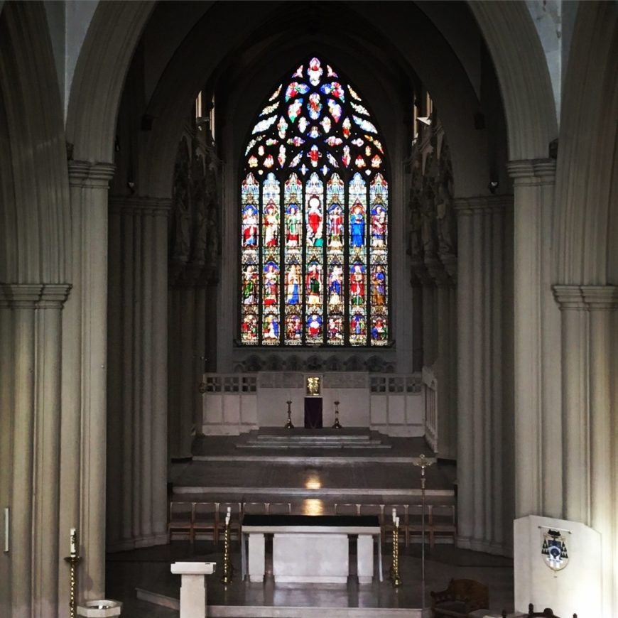 An image of the crossing sanctuary and cathedral altar,with the cathedra to the right