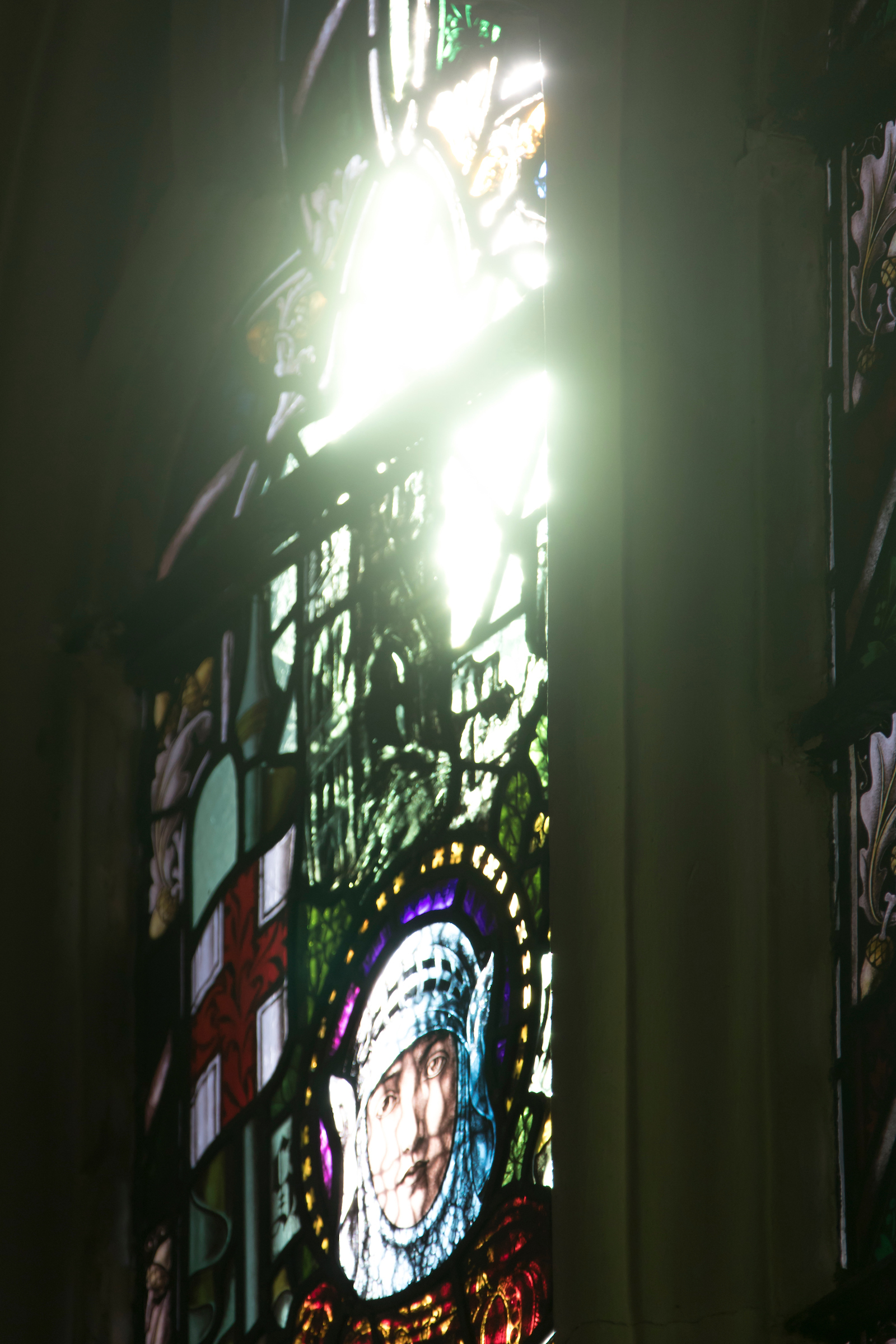 A photo of Our Stained Glass window of St.George shining light on the Cathedral