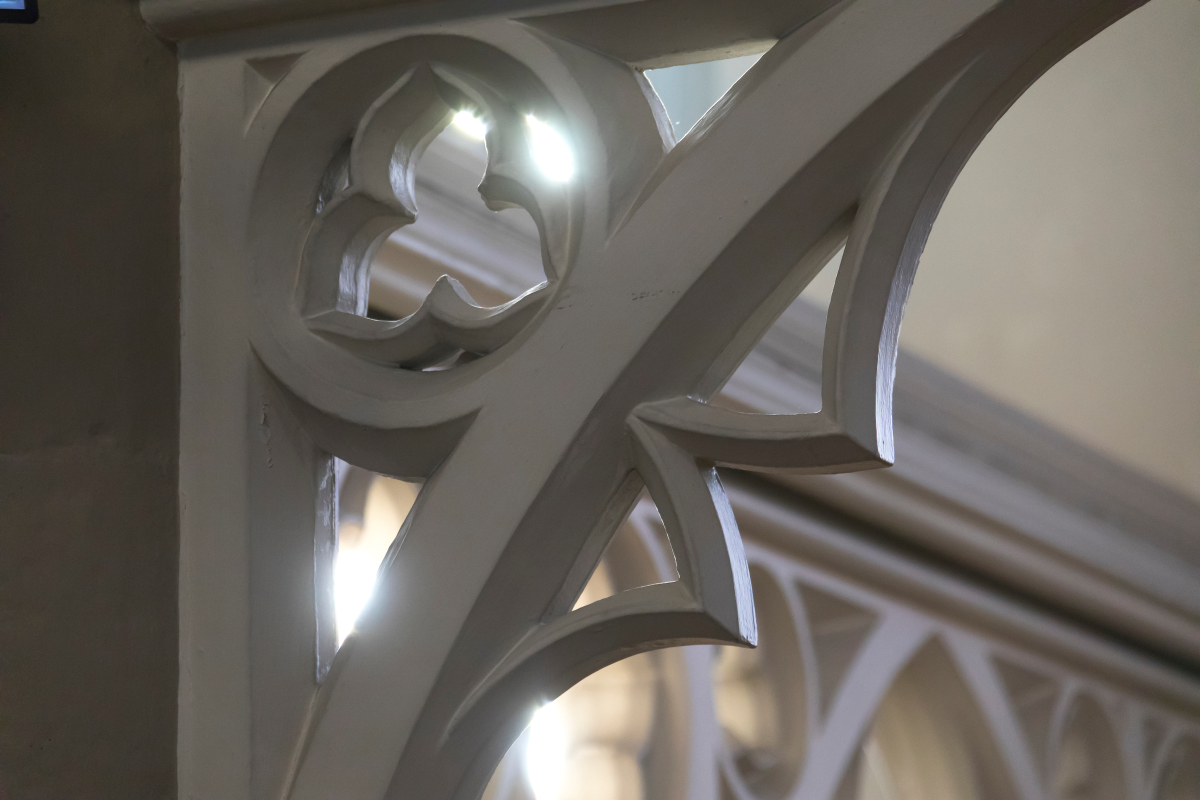 A photograph of Carved Details within our Ceiling mouldings