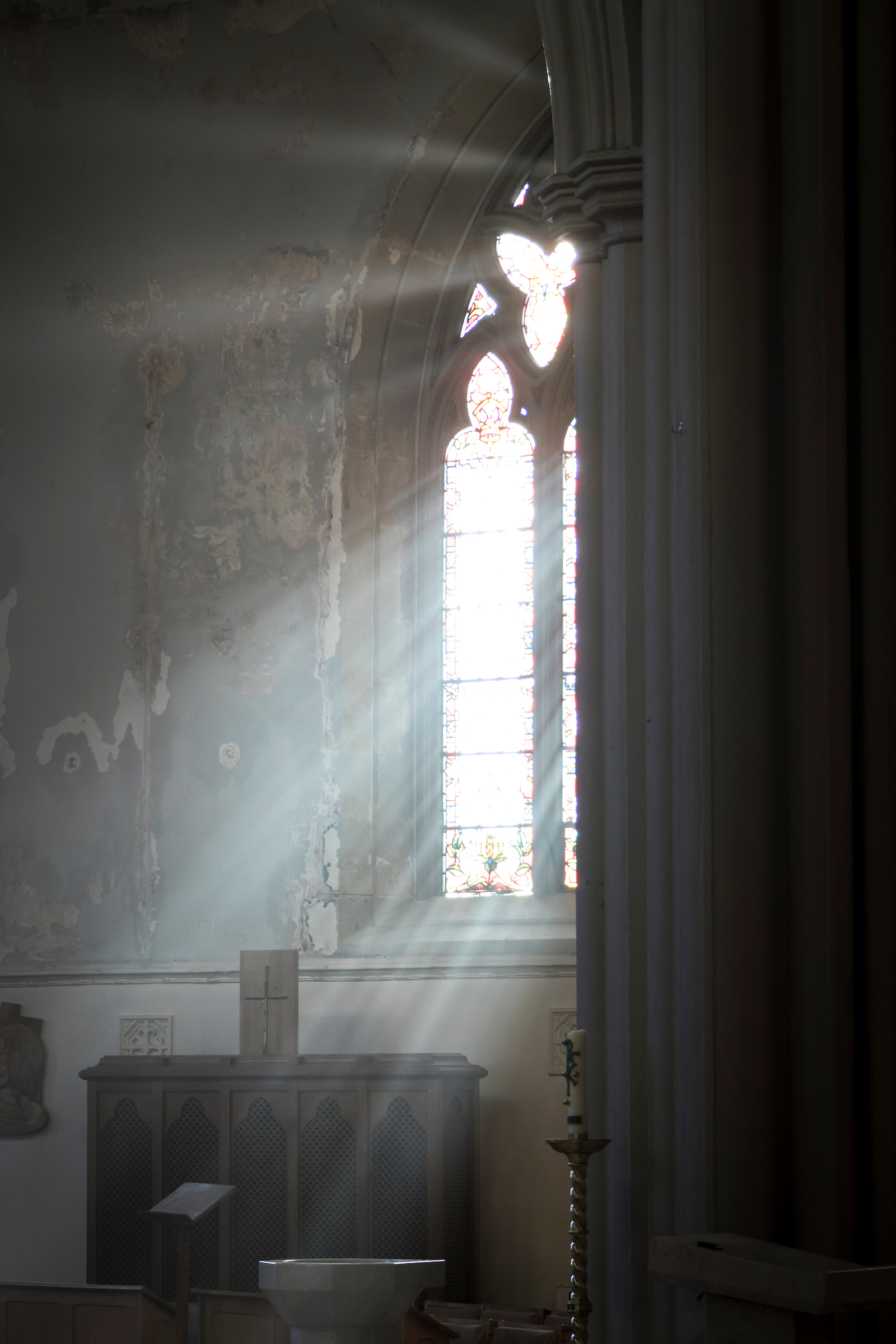 A Photograph showing A wonderful view of the sun shining through the side window pouring light into the cathedral